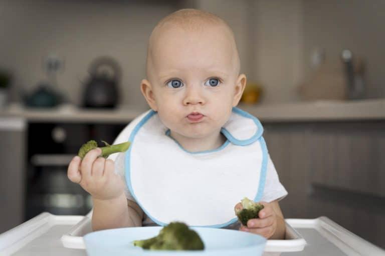 baby eating food himself BLM